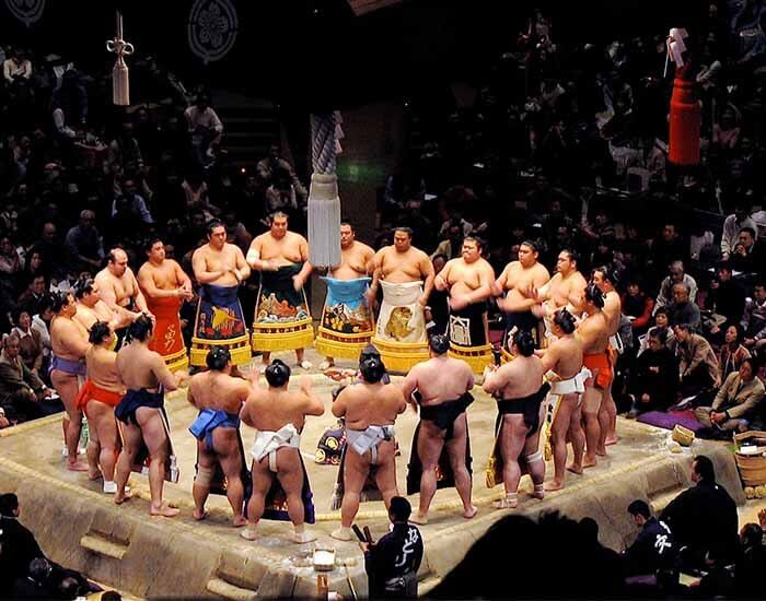 Sumo wrestlers wearing keshō-mawashi during the ring entrance ceremony